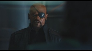 Nick Fury with his bluetooth headset hanging off his ear.Okay we can make a naval airship fly and turn it invisable but we still have these garish things on our ears?Bullshit.