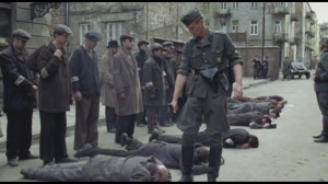 The Nazi guy is executing some Jews and runs out of bullets,i'd hate to be the next guy waiting to get shot.